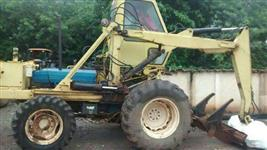 Trator Ford/New Holland 6630 4x4 ano 98 com implemento motocana super 2000