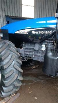 Trator New Holland TM 140 4x4 ano 99
