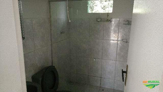 Trco casa em Nanuque MG por retroescavadeira