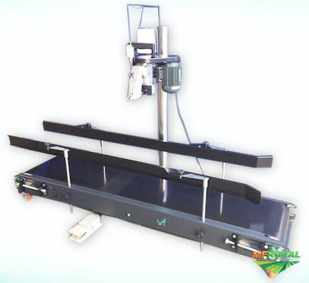 Sistema de costura em esteira com costuradora portátil