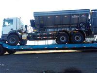 Transporte de máquinas e implementos agrícolas, peças ou máquinas industriais.